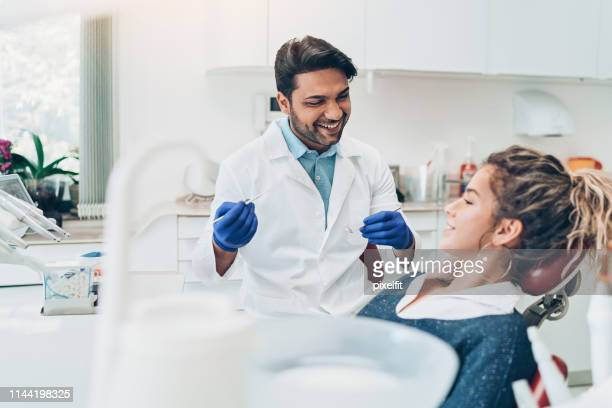 young woman during a dental check-up - dental equipment stock pictures, royalty-free photos & images