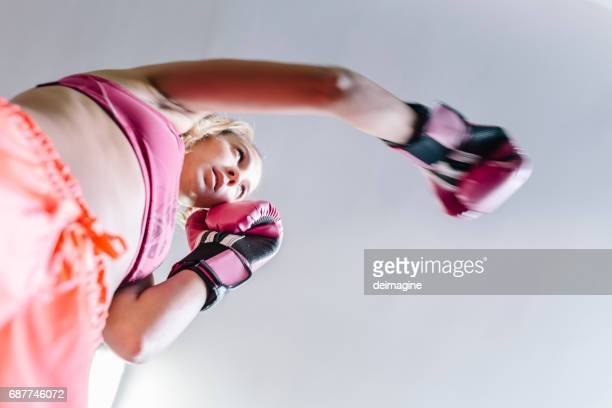 Young woman during boxing training