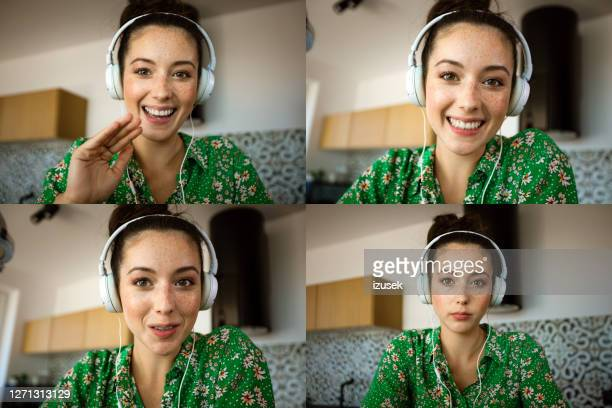 young woman during video call - looking at camera stock pictures, royalty-free photos & images