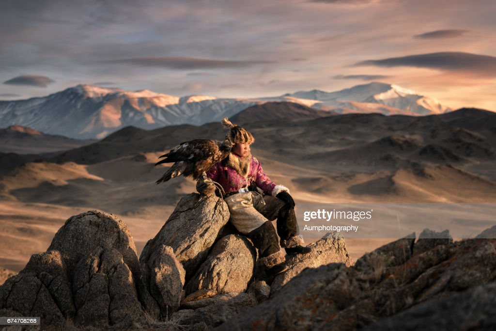 Young woman eagle hunting from the Altai moutains, Mongolia : Stock Photo