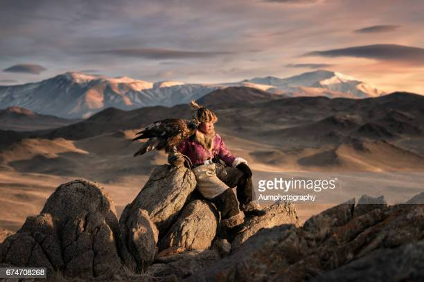 young woman eagle hunting from the altai moutains, mongolia - mongolian women stock photos and pictures