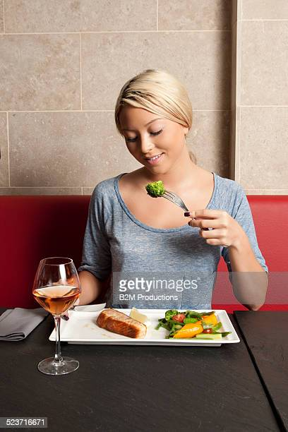 Young woman eating a meal