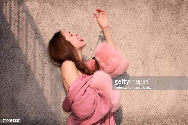 Young Woman Eating Chewing Gum