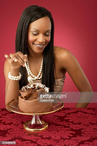 Young Woman Eating Chocolate Dessert