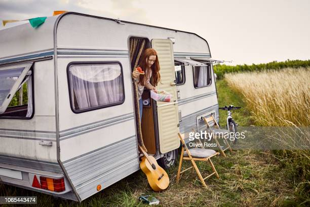young woman eating watermelon in caravan - camper trailer stock pictures, royalty-free photos & images