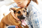 Young Woman Embracing Dog