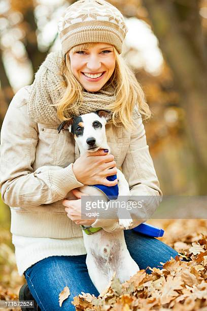 Young Woman Embracing her dog.