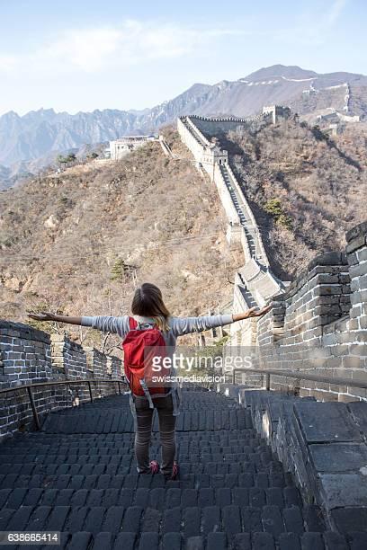 Young woman embracing nature-Great Wall of China