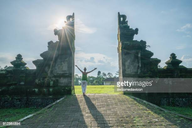 Young woman embracing travel adventure at Bali gate,Indonesia