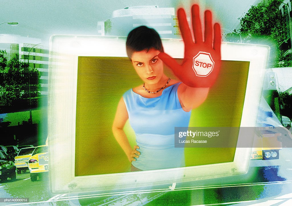 Young woman emerging from computer monitor, hand toward camera, the word stop on hand, digital composite. : Stockfoto
