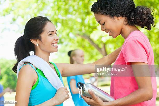Young woman encouraging friend before workout