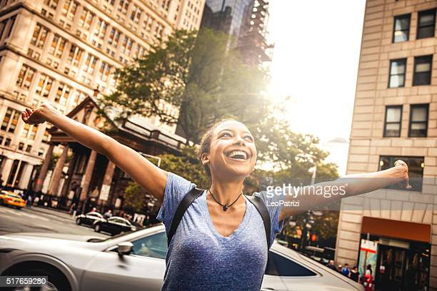 Young woman enjoy freedom in the city park