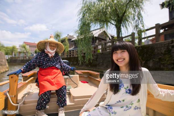 Young woman enjoy sightseeing on boat