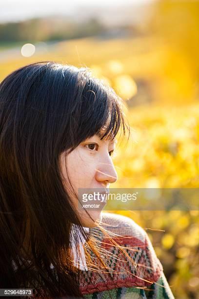 Young woman enjoy sunshine in golden vineyard