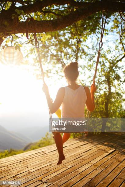 young woman enjoying a beautiful view in the nature - wonderlust stock pictures, royalty-free photos & images