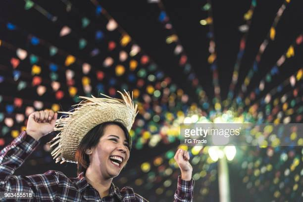 young woman enjoying a great time in the famous brazilian junina party (festa junina) - caipira style - tradition stock pictures, royalty-free photos & images