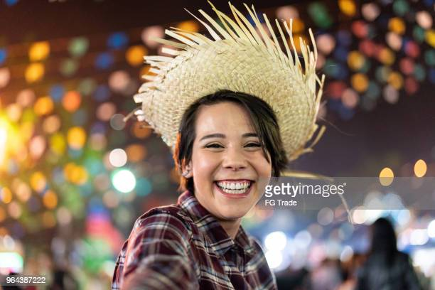 Young woman enjoying a great time in the famous Brazilian Junina Party (Festa Junina) - Caipira style