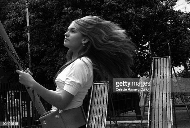 Young woman enjoying a ride on a swing