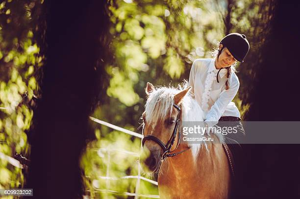Young Woman Enjoying a Ride on her Horse