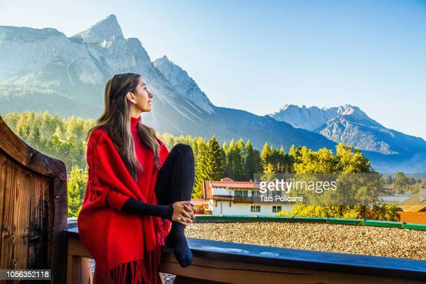 Young woman enjoying at a mountain resort in Tirol, Austria
