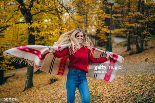young woman enjoying autumn - scarf stock pictures, royalty-free photos & images