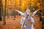 young woman enjoying autumn