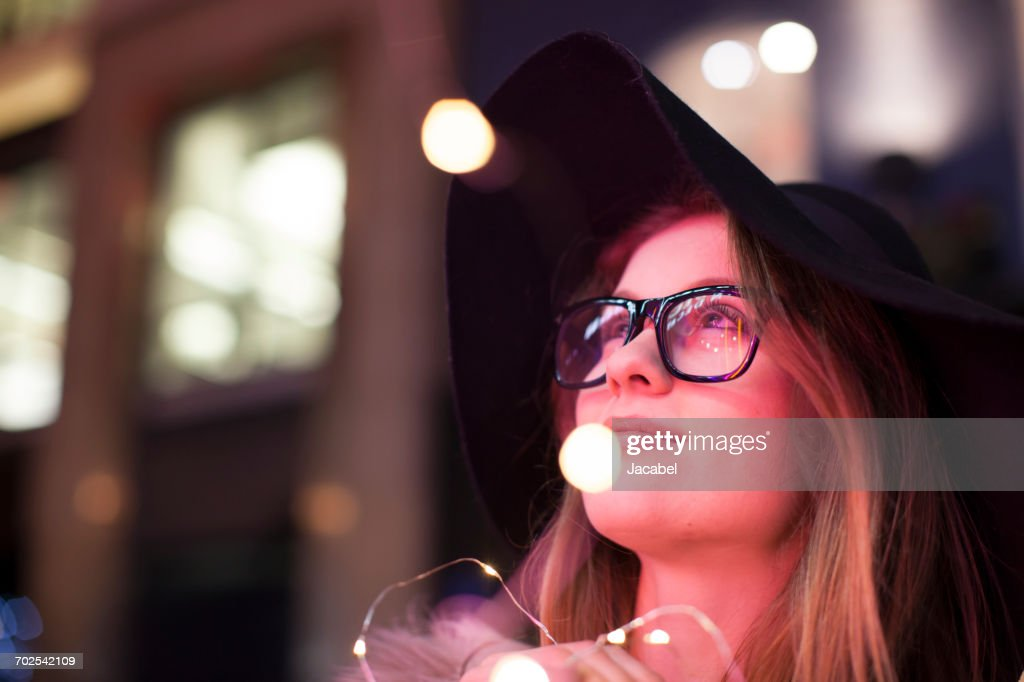 Young woman enjoying bright neon lights of street, London, UK : Stock Photo