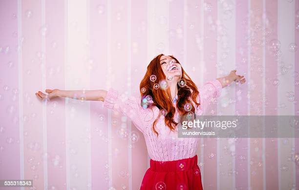 Young Woman Enjoying Bubbles Around Her