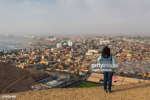 young woman enjoying city view - lima peru stock photos and pictures
