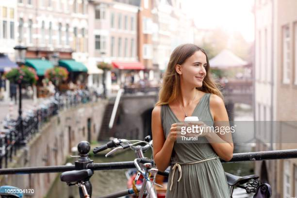 young woman enjoying coffee break - utrecht stock pictures, royalty-free photos & images