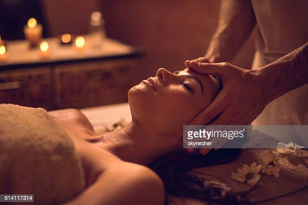 young woman enjoying during head massage at the spa. - indulgence stock photos and pictures