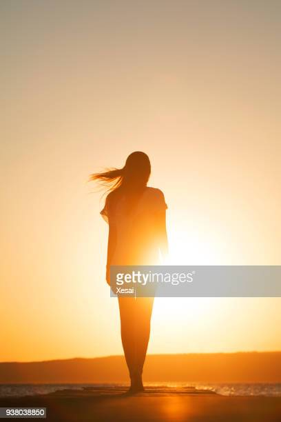 young woman enjoying freedom - back lit stock pictures, royalty-free photos & images