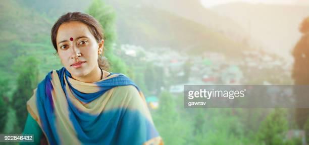 Young woman enjoying fresh air and looking at camera.