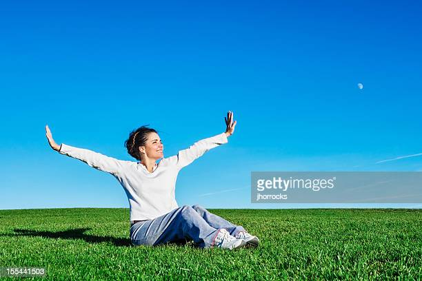 young woman enjoying fresh air - long sleeved stock photos and pictures
