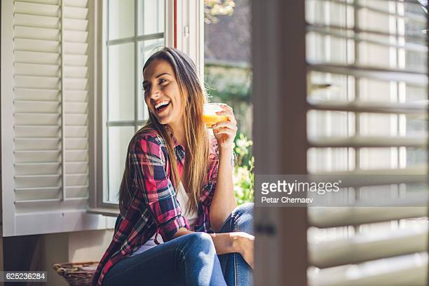 Young woman enjoying fresh orange juice