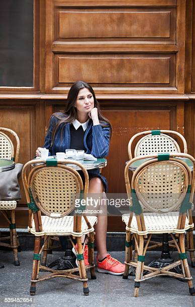 young woman enjoying her coffee break - french cafe stock photos and pictures