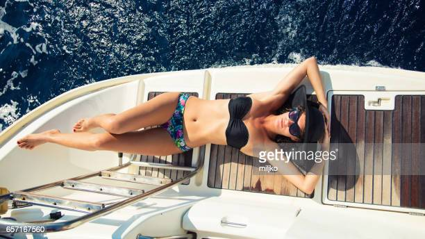 Young woman enjoying her vacation on sailboat