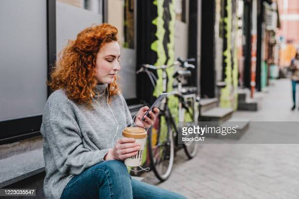young woman enjoying in the city - one young woman only stock pictures, royalty-free photos & images