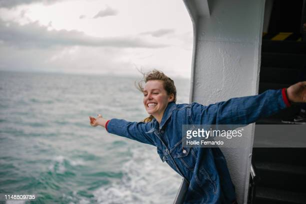 young woman enjoying life on ferry 2 - carefree stock pictures, royalty-free photos & images