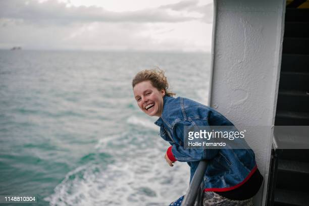 young woman enjoying life on ferry 3 - facial expression stock pictures, royalty-free photos & images