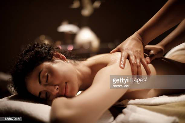 young woman enjoying massage - massage stock pictures, royalty-free photos & images