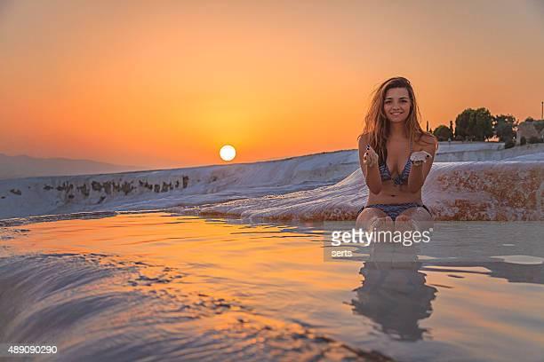 young woman enjoying pamukkale, turkey at sunset time - beautiful turkish girl stock pictures, royalty-free photos & images