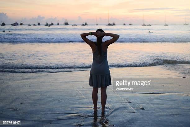 Young woman enjoying sea's view at sunset