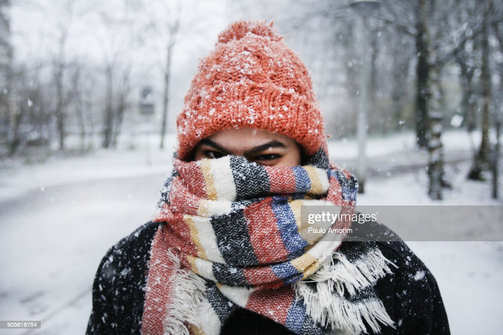 A young woman enjoying snowfall in Amsterdam : Stock Photo