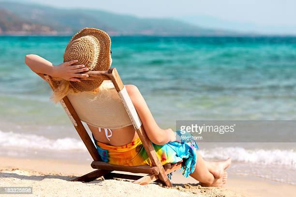 Young woman enjoying summer at the beach