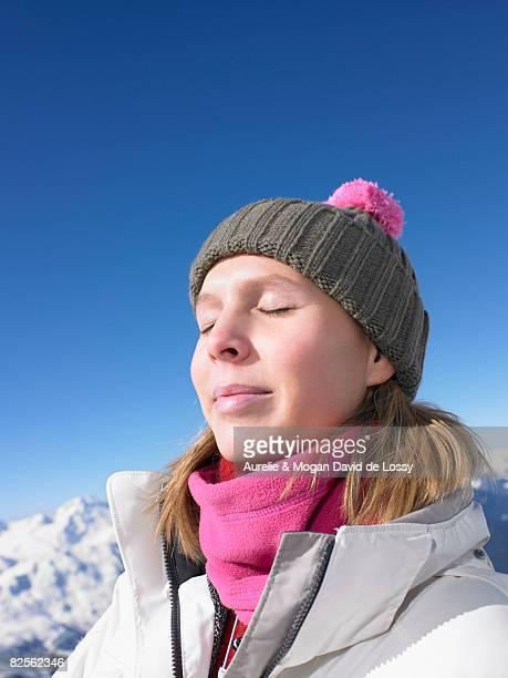 Young woman enjoying sun at mountains