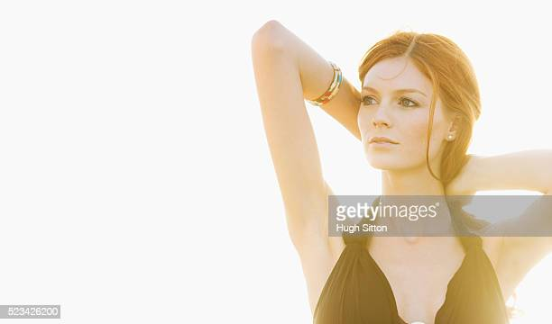 young woman enjoying sunset - hugh sitton stock pictures, royalty-free photos & images