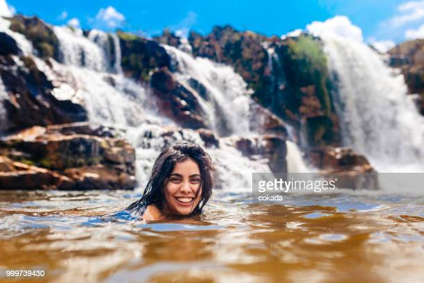 young woman enjoying the cascade of leathers, chapada dos veadeiros - goias stock pictures, royalty-free photos & images