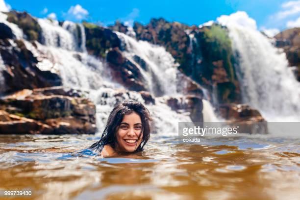 Young woman enjoying the Cascata dos Couros, Chapada dos Veadeiros