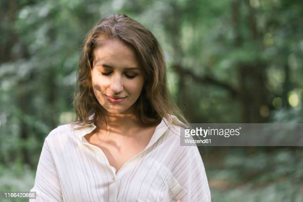 young woman enjoying the forest - eyes closed stock pictures, royalty-free photos & images